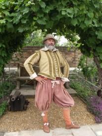 A Tudor gentlement enjoying the delights of the restored knot garden.