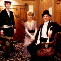 L-R: Michael Patterson, Claire and Peter Mitchell with their collection of RMS Olympic interior fittings.