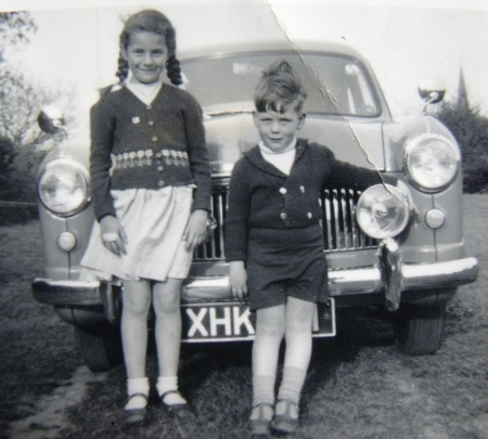 My aunt and uncle standing in front of their dad's Ford Zephyr. Galleywood Common. 1955.