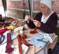 A member of Tudor re-enactment group, The Hungerford Household. Tudor knitting.