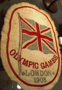 Emblem worn by 1908 British Olympian Clarence Brickwood Kingsbury. Clarence won two gold medals in cycling. The emblem was sewn onto the front of his jersey. From a recent display about Clarence at Portsmouth City Museum.