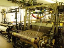 Loom 10 in the weaving shed showing a Hattersley Dobby loom by William Smith & Bros Ltd of Heywood Lancashire, built in the nineteenth century.