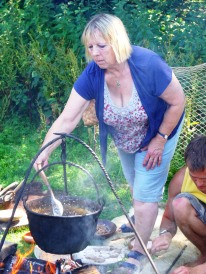 Jacqui Wood demonstrating prehistoric cooking techqniques at Buckland Ring Iron Age hillfort, Lymington, Hampshire.