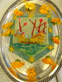Marchpane made by Mike and Jasmine Goodman. Mike's marchpane depicts Lymington's Coat of Arms, a sailing vessel.
