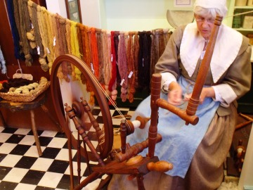 Sandra Costello and her excellent spinning demonstration at the Stuart Banquet event, St. Barbe Museum, Lymington, Hampshire.