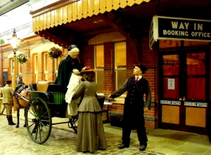 Replica of Chesil Street Station in Winchester and an arriving Governess Cart. Milestones.