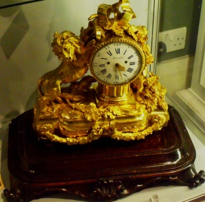 This object caught my eye in the jeweller's and watchmaker's shop. It is a bracket clock in a gilt brass case by J. R. Arnold. English, London. c.1843. The clock would once have been covered by a glass dome.