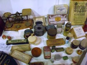 A Victorian chemist's shop window. Milestones.