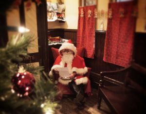 Father Christmas in his grotto at Milestones.