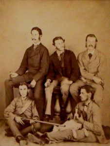 Top Row (L-R) - W. E. Oates, Mr Gray, Mr Buckley. Bottom Row (L-R), Thomas Bell (W.E. Oates's servant), Frank Oates with his favourite pointer, Rail.