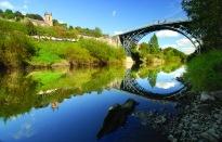 ©Ironbridge Gorge Museum Trust. View of the Iron Bridge over the River Severn.