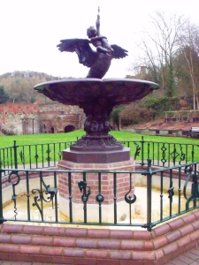 ©Come Step Back in Time. The Boy and Swan Fountain cast by the Coalbrookdale Company in 1851 for the Great Exhibition. The remains of the Old Furnaces at Upper Works can just be seen in the background.