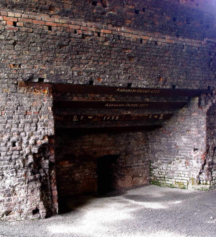 The Tapping Arch, Upper Works, Coalbrookdale. The dates on the cast iron beam refer to Abraham Darby III's enlargement of the furnace in 1777, probably to increase capacity for the construction of the world's first Iron Bridge in the Gorge.©Come Step Back in Time