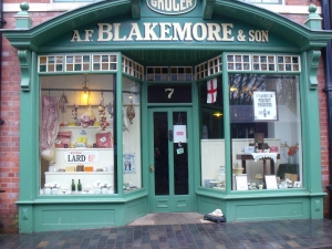 ©Come Step Back in Time. Grocery and Provisions Shop (A.F. Blakemore & Son), no. 7 High Street. An exact replica of Owen's Grocer's shop and warehouse, Market Street, Oakengates, Telford, Shropshire. c.1890. Many of the items on display in the shop are from Chester's Salopian Stores, Westbury, Shropshire. The shop opened on site on 14th July 2000.