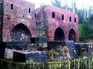 Remains of Madeley Wood Company Blast Furnaces, Blists Hill, Ironbridge. Base of the first furnace, 1832; base of second and south engine house, 1840; base of third, 1844; north engine house c. 1873. The furnaces were blown out in 1912. ©Come Step Back in Time