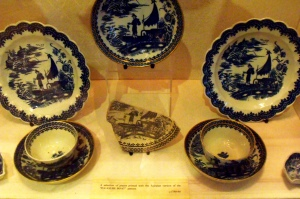 ©Come Step Back in Time. Examples of Caughley porcelain, the 'pleasure boat' design. c.1780-90. Caughley porcelain is identified by its distinctive blue and white colour scheme and designs inspired by the Far East.