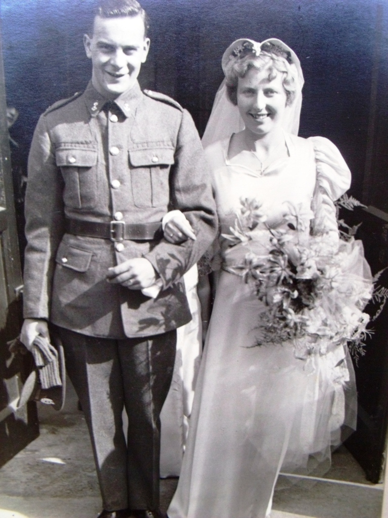 My grandparents on their wedding day in 1940. My grandmother wore a blue satin bias cut wedding gown.