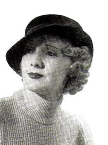 1930s fashion for curls pinned on one side.