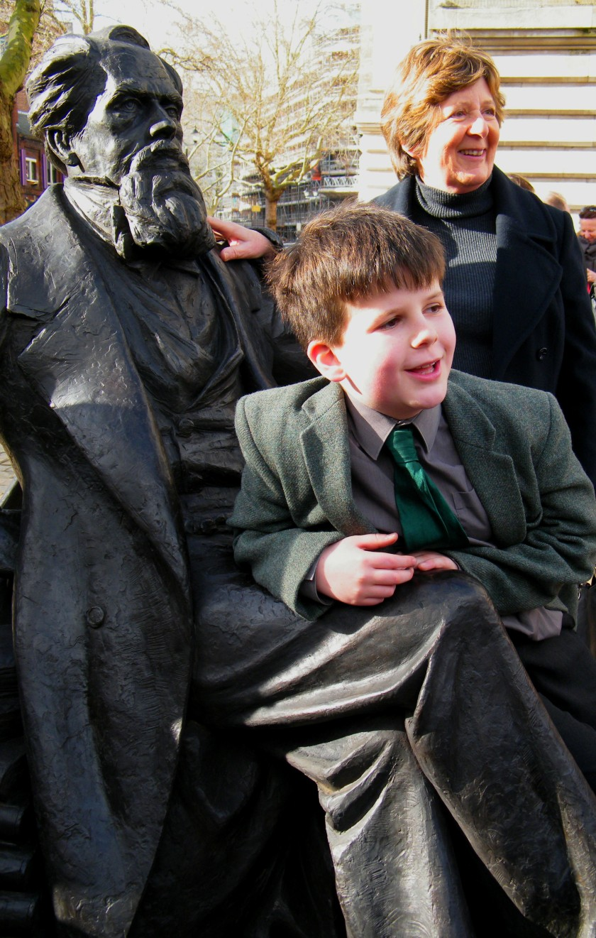 Oliver Dickens, the 9 year-old great, great, great, grandson of Charles Dickens. Jane Monk (on right) is Dickens' great, great, granddaughter. Jane has been photographed with all three statues of her ancestor. © Come Step Back in Time.