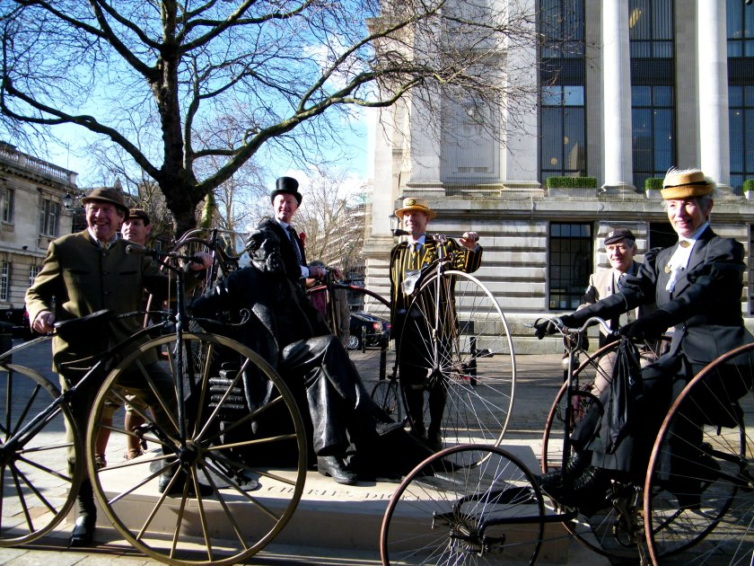 The Pickwick Cycle Club on their Penny Farthings posing for photographs alongside Charles Dickens. © Come Step in Time.