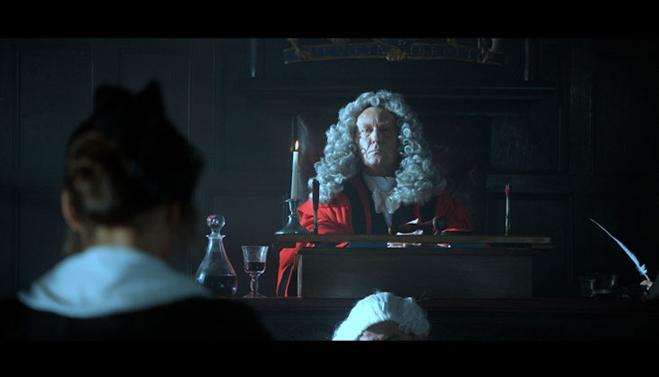 Molly standing trial for the murder of Bessie Watts. Film still from