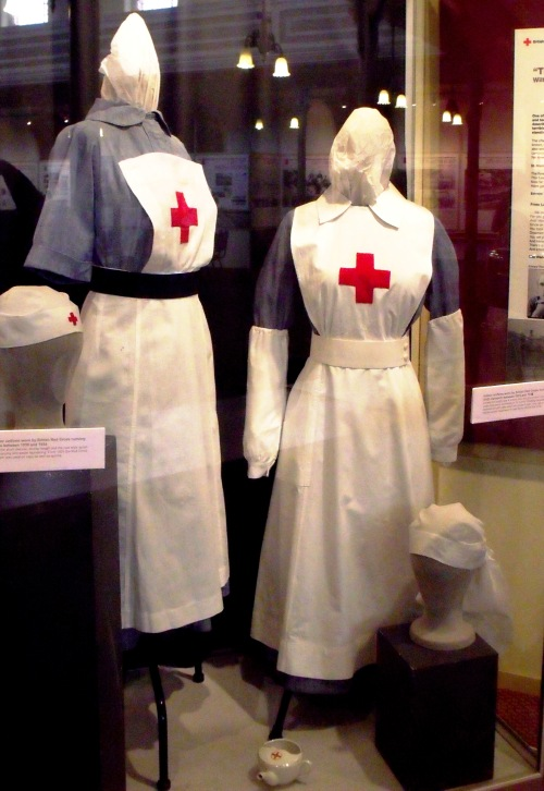Uniforms worn by the British Red Cross Nursing VADs in both World Wars. Left-hand side is World War Two and right-hand side is World War One. On display at the Heritage Centre, Royal Victoria Country Park, Netley, Hampshire.