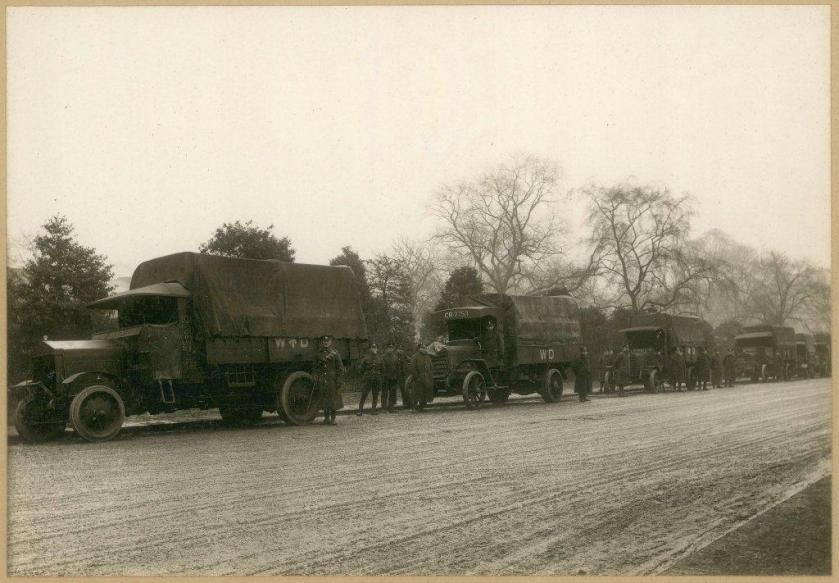 A line of motor vans in reverse during World War One.