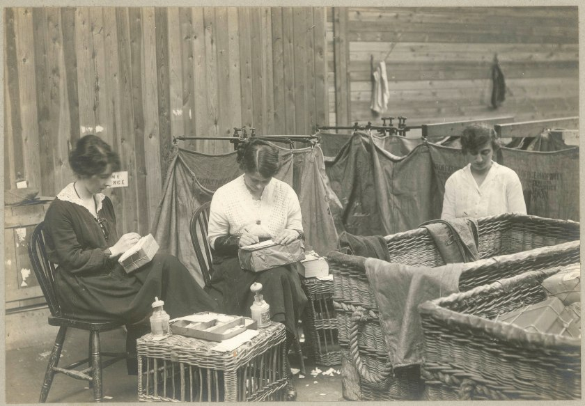 Women engaged in mending parcels during the First World War. ©Royal Mail Group Ltd., Courtesy British Postal Museum Archive (BPMA).