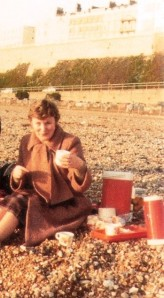 My mum enjoying a Winter picnic on Brighton beach, c.1984. We visited the seaside whatever the weather. True Brit grit! ©Come Step Back In Time.
