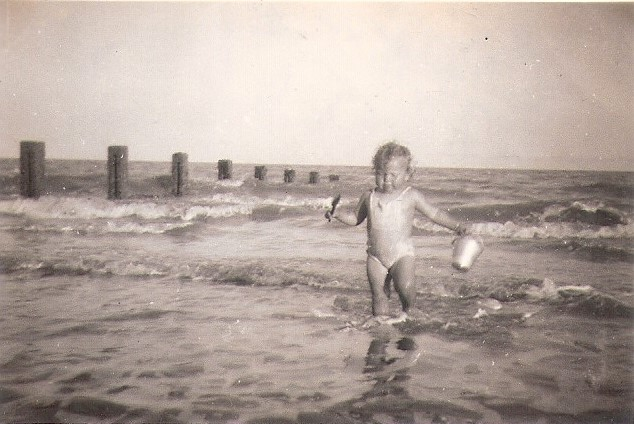 My mum enjoying the seaside on Hythe beach, Kent, just after the Second World War, c. 1946. ©Come Step Back In Time.