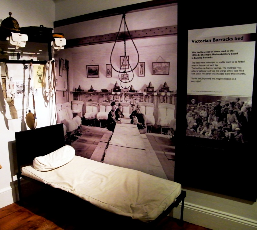 Copy of the telescopic bed used in the 1890s by the Royal Marine Artillery based in Eastney Barracks. The beds had no foam or springs. The 'mattress' was called a 'Palliasse' and similar to a large pillow case filled with straw which was changed every three months. Exhibit from The Royal Marines Museum, Eastney, Hampshire. Image ©Come Step Back in Time.