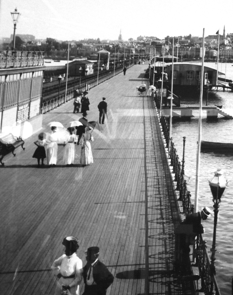 Ryde pier, Isle of Wight, early 1900s. Unchaperoned young ladies walking along the promenade.