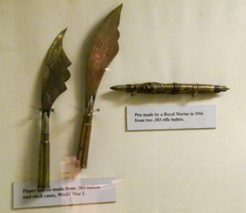 Lovely examples of Trench Art on display in the World War One Gallery at the Royal Marines Museum, Southsea, Hampshire. (Left) Paper knives made from .303 bullets and shell cases. (Right) Pen made by Royal Marine in 1916 from two .303 rifle bullets. Another example of Trench Art, World War One. Two shell cases on display at Corfe Museum, Dorset. ©Come Step Back In Time.