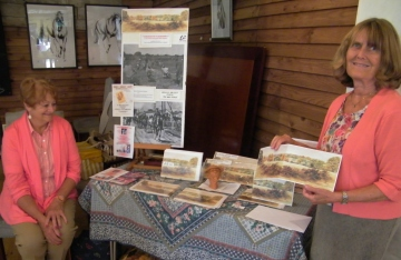 Rex Trayhorne's wife, Geraldine (right) holding the greetings card depicting 'View From Pauncefoot Hill' which is being sold to help with fund-raising for the project. On the left is Geraldine's friend, Barbara Milburn. ©Come Step Back In Time.