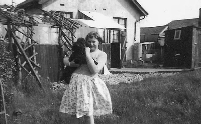 Daughter of family friend with Inky the poodle in the garden at the Hythe bungalow, Summer 1955. ©Come Step Back In Time