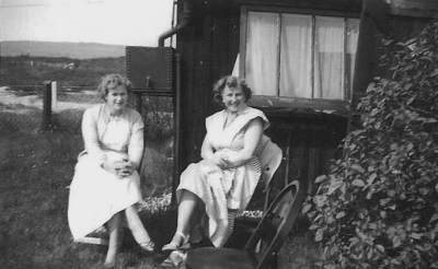 Grandmother (right) with her friend Rita in the garden at the bungalow in Hythe. Summer 1955. ©Come Step Back In Time
