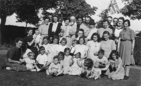 VE day party May 8th 1945. Cuckoo farm , Boxted , Colchester.  Victory in Europe day 8th May 1945. A celebration party at Cuckoo Farm near Colchester Essex England. party was held for the local community by the Joy family who owned the land . Mum in the middle of the picture would be waiting till August for VJ day and the end of the second world war. Colchester's new football stadium is at this location today. Image courtesy of Glenn Pattinson (Glenn's Flickr account is full of lovely heritage images, click here).