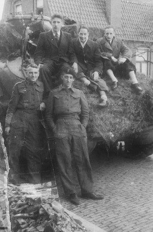 Allied soldiers by their camouflaged tank during Hengelo's liberation. Image courtesy of Eric Heijink (http://www.secondworldwar.nl/hengelo-1940-1945.php)