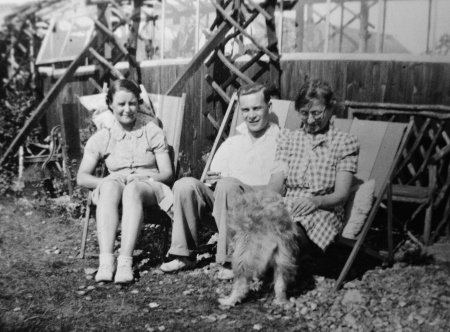 In the garden at the bungalow, Summer 1946. My grandfather is in the centre.  ©Come Step Back In Time