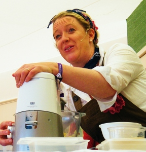 Great British Bake-Off finalist, Miranda Gore Browne demonstrating cake-making in The Kenwood Kitchen Theatre. ©Come Step Back In Time