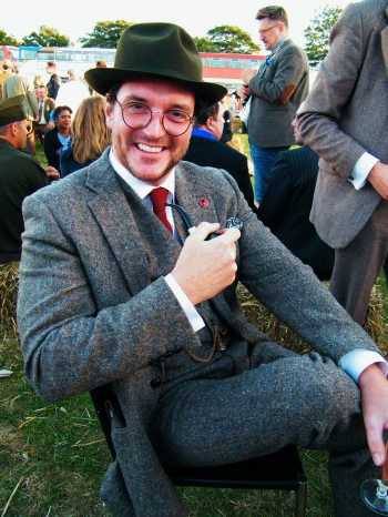 A rather dapper gentleman from The Chap Magazine relaxing after a long day at Goodwood Revival 2015. ©Come Step Back In Time