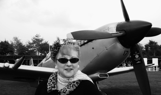 Me reporting on The Battle of Britain anniversary at Goodwood Revival for Solent TV. ©Come Step Back In Time