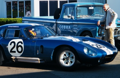 Driver N. Minassian in a 1965 Shelby Cobra Dayton Coupé. Peter Brock Looks on. Goodwood Revival 2015. ©Come Step Back In Time