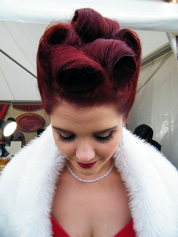 Example of Gloria's technical expertise in creating the perfect Victory Roll. Model is Miss Scarlett Luxe. Goodwood Revival 2015. Gloria with one of her former students, Mellisa Holme. Mellisa was working at Vintage Hair Lounge's pop-up salon at Goodwood Revival 2015. Mellisa now runs her own salon on the Isle of Wight, Six Hair Studio and Upper Six, Ryde, Isle of Wight. ©Come Step Back In Time