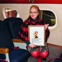 Me in top aft cabin of Beachcomber with photo of Maureen O'Hara.